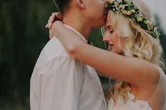 Boyfriends embracing with defocused background
