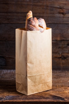Bread rolls tucked into a paper bag