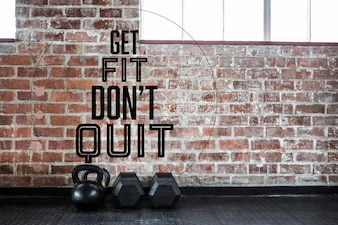 Brick wall and dumbbells