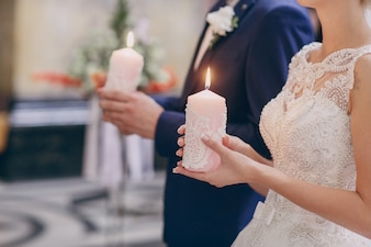 Bride and groom holding candles