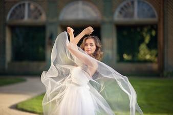 Bride dancing in front of building