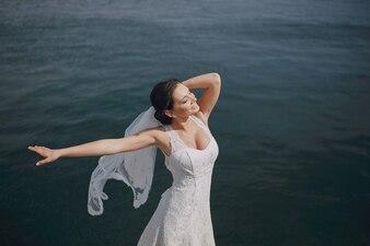 Bride dancing in the sea