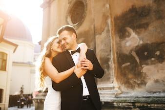 Bride embracing behind her boyfriend