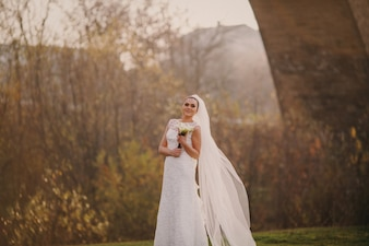Bride in the forest with a bouquet