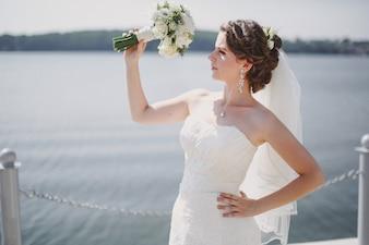 Bride looking his bouquet