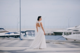 Bride looking the boats