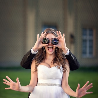 Bride looking through lenses screaming