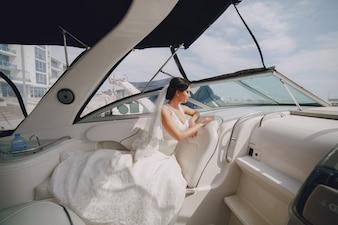 Bride lying on a boat