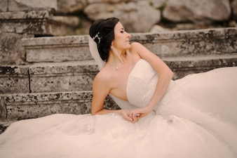 Bride lying on a stair