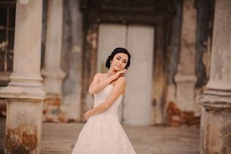 Bride posing between columns