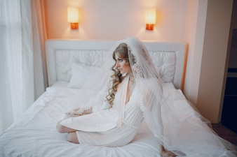 Bride posing on a bed