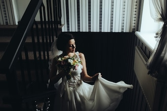Bride posing on the stairs