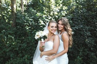 Bride posing with bridesmaid