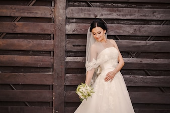 Bride posing with wedding dress