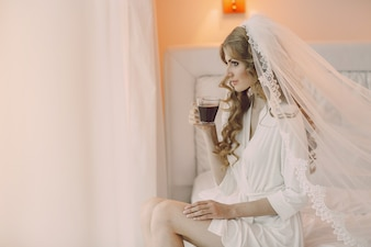 Bride sitting with a cup