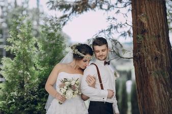 Bride smelling her groom