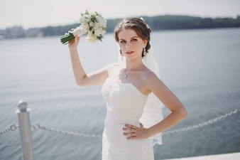 Bride with a bouquet in the sea