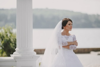 Bride with a lake background