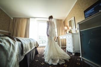 Bride with dress in a room