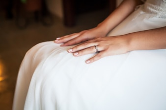 Bride with hands on legs