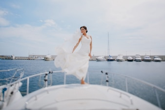 Bride with her dress in the wind