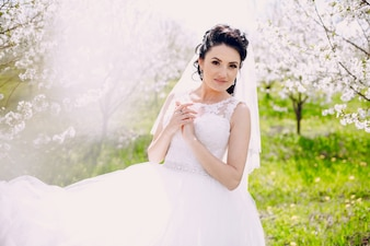Bride with her wedding dress on a sunny day