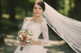 Bride with veil and bouquet