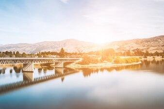Bridge crossing a lake at sunset