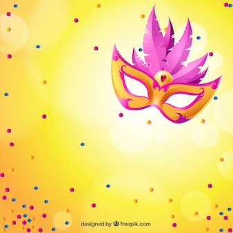 Bright carnival mask with pink feathers