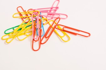 Bright paper clips on white