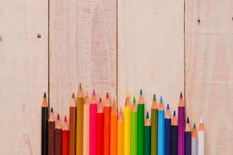 Bright pencils on wood