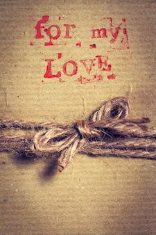 Brown gift with the phrase  for my love  and a rope