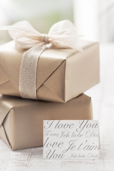 Brown gifts with a white tie and a note