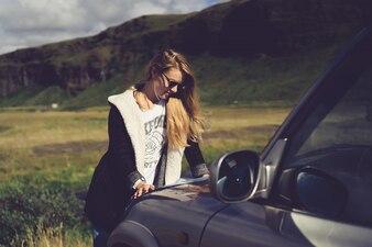 Brown hair girl sitting vehicle