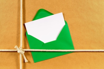 Brown paper parcel with green envelope