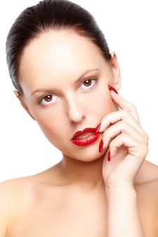 Brunette gorgeous facial touching posing