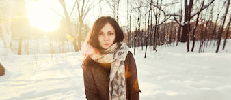 Brunette woman spending the day in snowy field