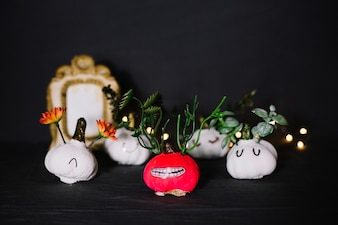 Bunch of funny decorated garlic