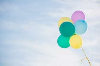 Bunch of pastel color balloons floating in the air