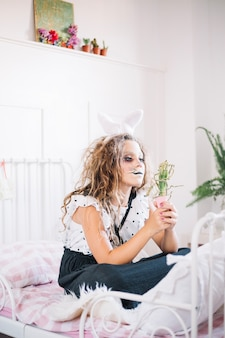 Bunny girl with plant in bedroom