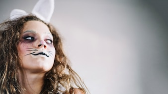 Bunny girl with whiskers looking away