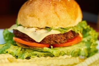 Burger lettuce cheeseburger fat close up