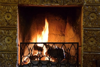 Burning fuel in fireplace