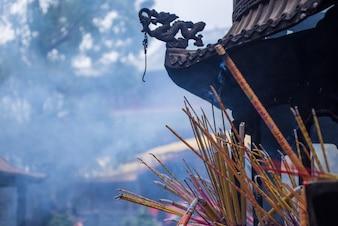Burning incense in a censer