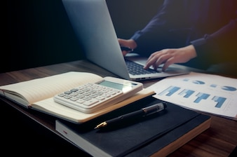 Business accounting women work with calculator and Laptop. Financial technology concept