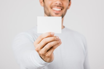 Business card template with young man at the background
