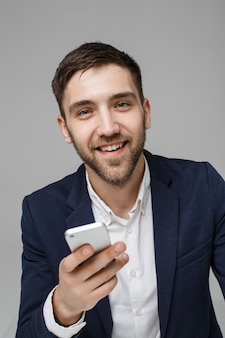 Business Concept - Portrait Handsome Business man playing phone with smiling confident face. White Background.Copy Space.