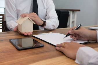 Business man signing contract making a deal with  real estate agent Concept for consultant.