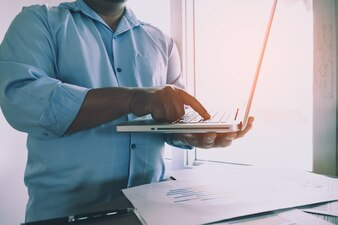 Business man working at office with labtop and documents on his desk