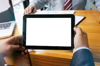 Business People using tablet, touchpad at meeting.